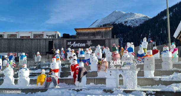 Tens of snowmen replace live audience at spectators tribune during the women's downhill of the FIS Alpine Ski World Cup on January 9 in St.Anton ,...