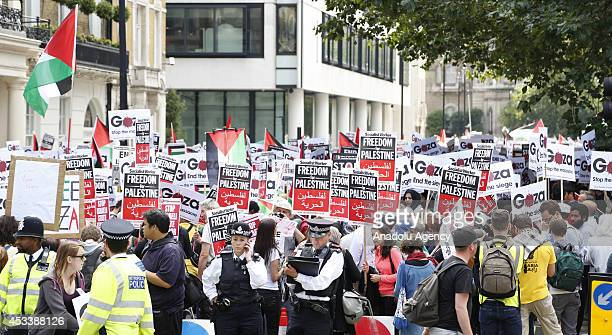 Tens of thousand people stage a huge demonstration to protest the ongoing Israel's Gaza attacks in London England on August 9 2014 Demonstrators hold...