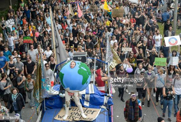 Tens of thousands demonstrate during a protesters march against the G20 Summit with the topic 'Solidarity without borders instead of G20' on July 8...
