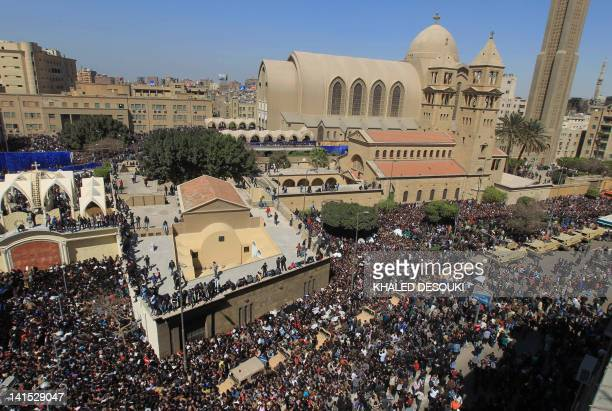 Tens of thousands Egyptian Christian Copts flock to the Saint Mark's Coptic Cathedral in Cairo's alAbbassiya district on march 18 2012 to bid...