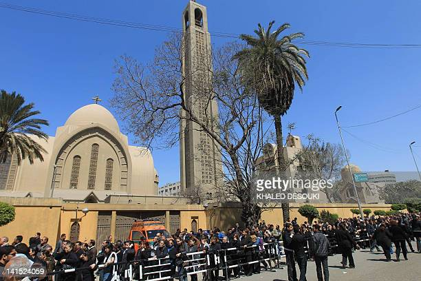 Tens of thousands Egyptian Christian Copts line up outside the Saint Mark's Coptic Cathedral in Cairo's alAbbassiya district on march 18 2012 to bid...