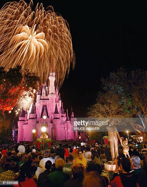 Tens of thousands enjoy fireworks at the Magic Kingdom in the Walt Disney World Resort in Lake Buena Vista, Fl, 31 December 1999.