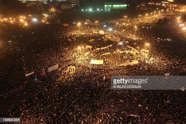 Tens of thousands of Egyptian protesters pack Cairo's landmark Tahrir Square on November 22 2011 as clashes between police and protesters demanding...
