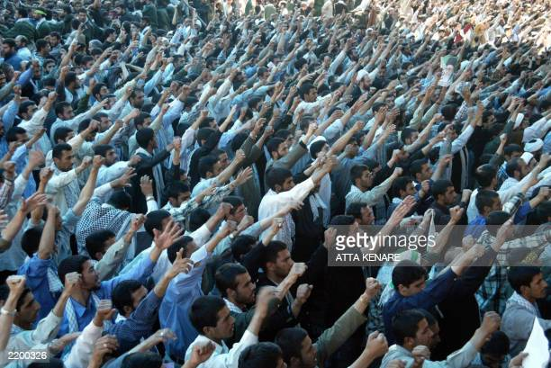 Tens of thousands of Iranians chant slogans 04 June 2003 while attending the speech of Iran's supreme leader Ayatollah Ali Khamenei at Khomeini's...