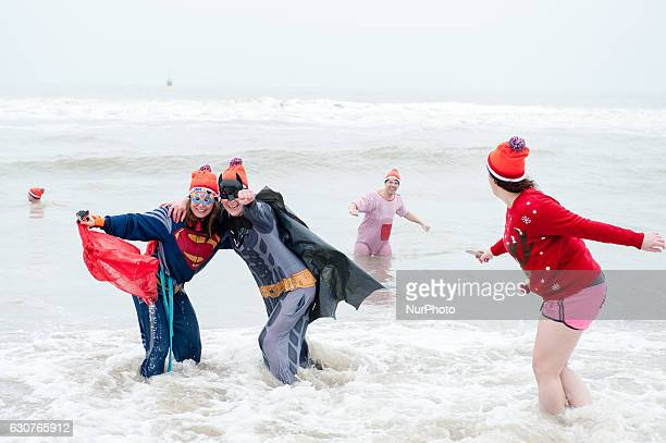 Tens of thousands of participants dip into the cold North Sea water every year in the Netherland's largest dive held at the beach of Scheveningen in...
