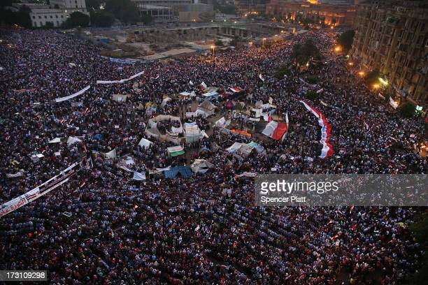 Tens of thousands of people attend a rally in Tahrir Square against ousted Egyptian President Mohamed Morsi on July 7, 2013 in Cairo, Egypt. Egypt...