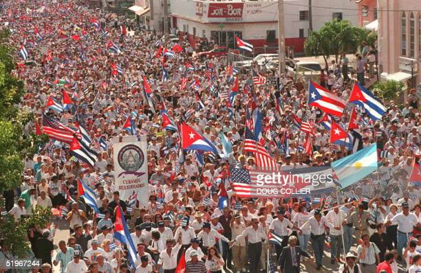 Tens of thousands of people mostly Cubans living in the US march through the streets of the Little Havana section of Miami Florida10 December during...