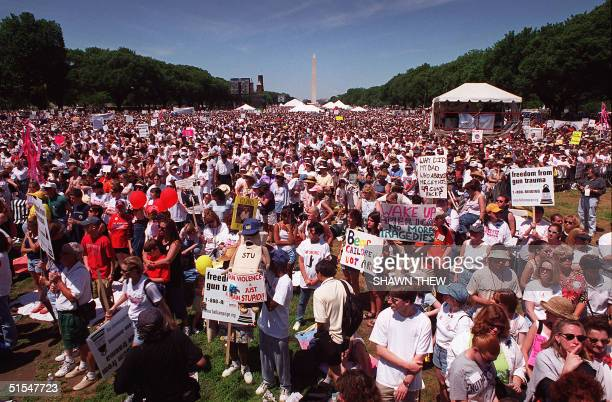 """Tens of thousands of people throng the National Mall during the """"Million Mom March"""" demonstration 14 May 2000 in Washington, DC. Mothers,..."""