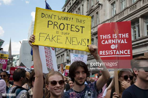 Tens of thousands of protesters gather to march and demonstrate at the Together Against Trump national demonstration on 13th July 2018 in London...