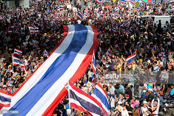 Tens of thousands of protesters have disrupted traffic at major intersections and marched on government offices in Thailand's large and hectic...