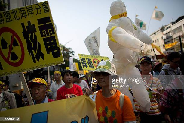 Tens of thousands of protesters rally to show their request to shutting down the island's nuclear power plants during an antinuclear rally on March 9...