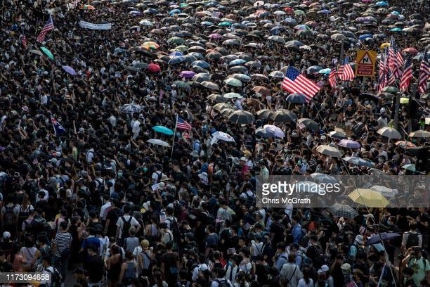 Tens of thousands of protesters walk through Central district during a march to petition the US Consulate on September 08, 2019 in Hong Kong, China....