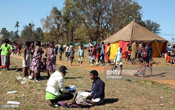 STORY Tens of thousands of Reed Dance maidens are housed in tents in several basecamps in Lobamba 1O kms from the capital Mbabane on August 24 2011...