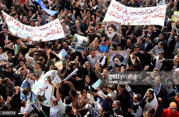 Tens of thousands of Shiite Muslims march peacefully to demand an elected government on January 19 2004 in Baghdad Iraq US and Iraqi officials are...