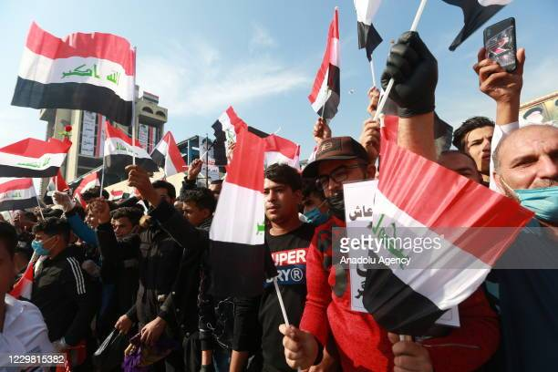 Tens of thousands of supporters of Shiite cleric Moqtada Sadr gather to perform Friday prayer despite the novel coronavirus pandemic at Tahrir Square...