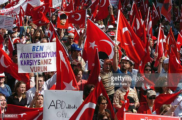 Tens of thousands of Turks wave Turkish flags as they attend the antigoverment rally May 5 2007 in western Turkish city of Manisa Tens of thousands...