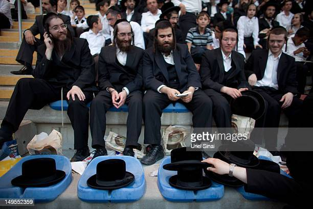 Tens of thousands of Ultra Orthodox Jews attend Siyum HaShas a celebration marking completion of a sevenand a half year daily studycycle of the...