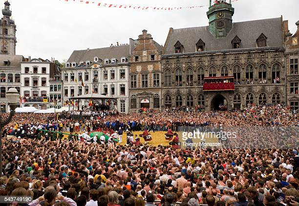 Tens of thousands of visitors gather at the Grand Place of Mons to see Saint George confronting the dragon known as Lumeçon fight during the festival...
