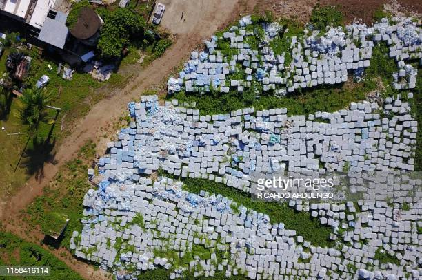 TOPSHOT Tens of thousands of water bottles meant for victims of Hurricane Maria are seen sitting in a vacant lot in Dorado 40 Km west of San Juan on...