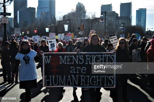 Tens of thousands of Women took to the Ben Franklin Parkway to mark the first year of Donald Trump's Presidency in protest in Philadelphia PA on...