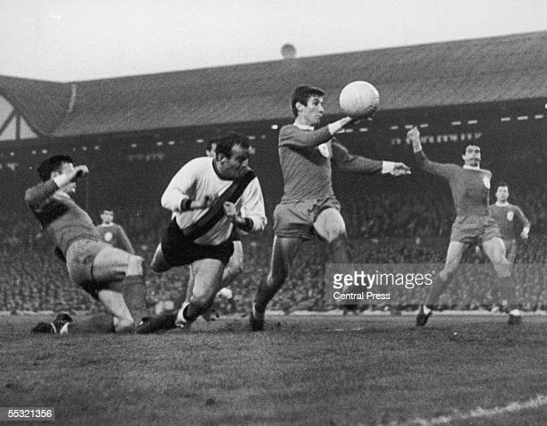 A tense moment for Liverpool players Tommy Smith and Geoff Strong as InterMilan player Mario Corso lunges in with a header during an attack by the...