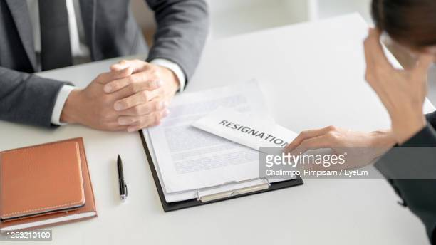 tensed businesswoman giving resignation letter to manager - quitting a job stock pictures, royalty-free photos & images