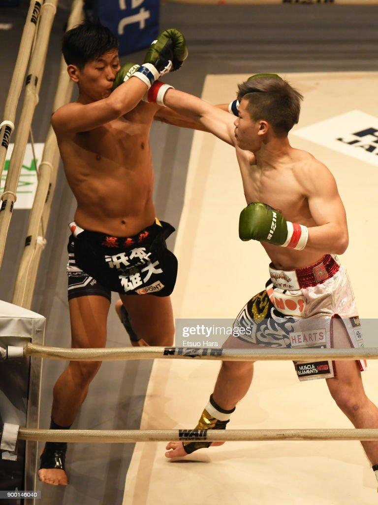 Tenshin Nasukawa (R) of Japan punctes Yuta Cat Hamamoto of Japan in the kick boxing bout during the RIZIN Fighting World Grand-Prix 2017 final Round at Saitama Super Arena on December 31, 2017 in Saitama, Japan.