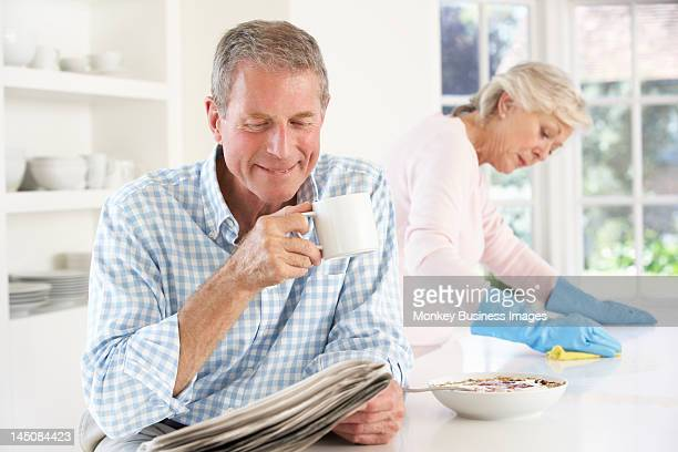 tension between retired couple - monkey eating paper stock pictures, royalty-free photos & images