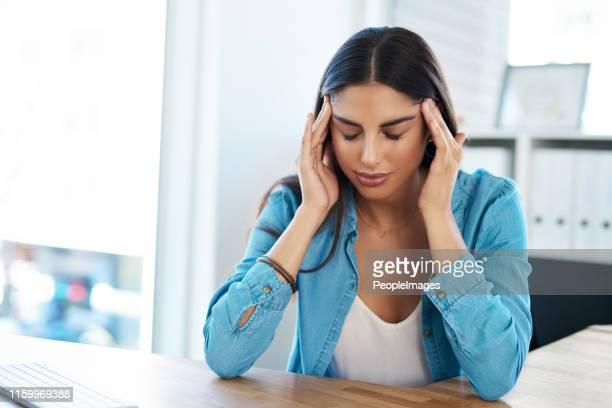tension headaches can really put a damper on your day - headache stock pictures, royalty-free photos & images