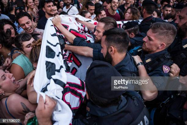 Tension in Rome Italy on June 11 2018 between police and protesters demonstrating against Italian government decision to block ports to a German NGO...
