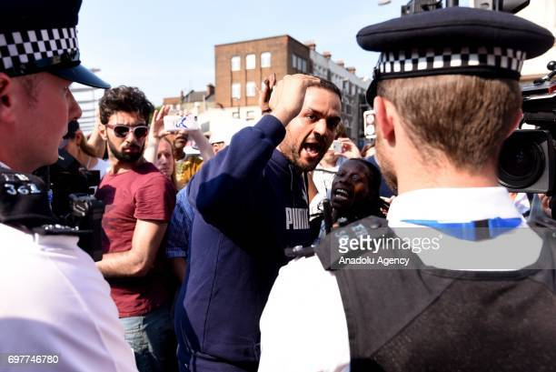 Tensions mount as Police officers stand on duty at a cordon near the scene in Finsbury Park area of north London after a vehicle hit pedestrians on...