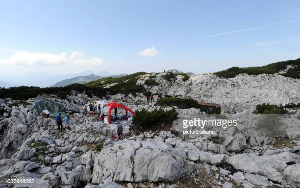 A tent and a container stand in position on the site near the entrance to the Riesending cave on the Untersberg mountain near Marktschellenberg...