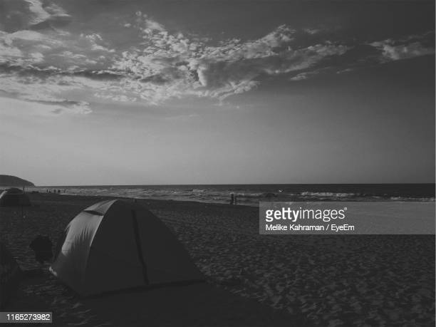 tent at beach against sky - melike stock pictures, royalty-free photos & images