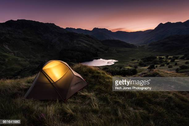 tent at dusk in english lake district - camping stock photos and pictures