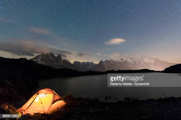 tent at lacs de chesery, france - aiguille de midi stock photos and pictures