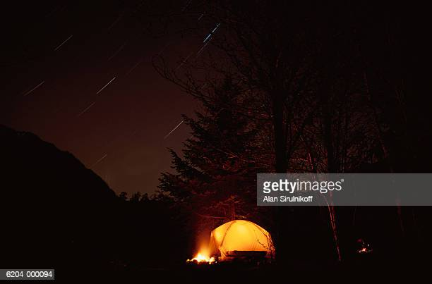 tent at night - sirulnikoff stock photos and pictures