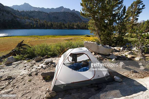 A tent camp at Arrowhead Lake along the John Muir Trail in the Sierra Nevada Mountains of California USA