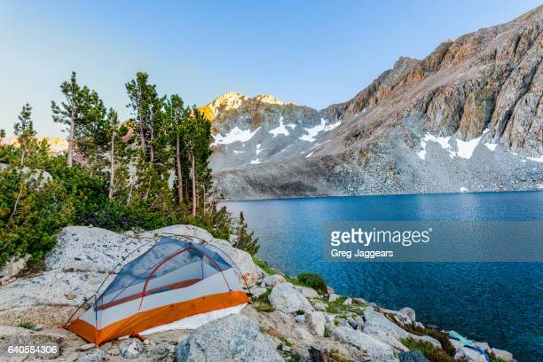 tent campsite on lake marjorie, californian sierra nevada - john muir trail stock photos and pictures