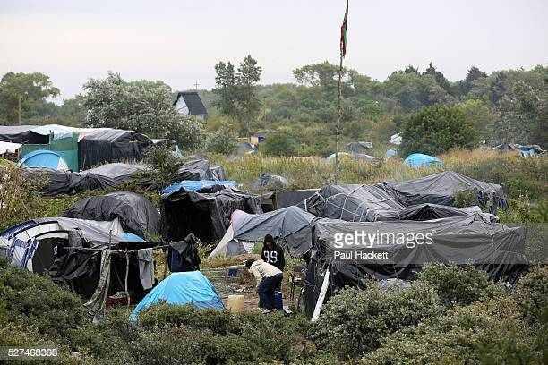 Tent city 'the Jungle' migrant camp in Calais France August 10 2015 The Calais jungle is the nickname given to a series of camps in the vicinity of...