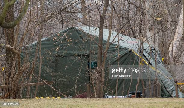 A tent covers the backyard of 53 Mallory Crescent as Toronto Police Service continues its investigation regarding charges related to Bruce McArthur...
