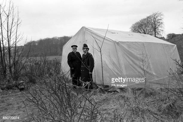 A tent covers the manhole where the body of Lesley Whittle was found hanging by a wire at the bottom of a shaft in Bathpool Park at Kidsgrove...