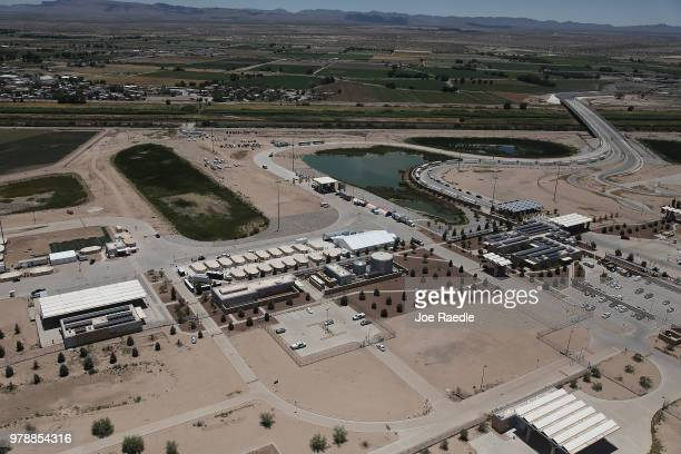 Tent encampment holding children of immigrants is seen recently built near the Tornillo Port of Entry on June 19, 2018 in Tornillo, Texas. Looking...