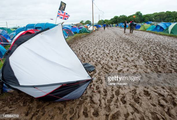 A tent is blown through the mud during day 1 of Download Festival at Donington Park on June 8 2012 in Castle Donington United Kingdom