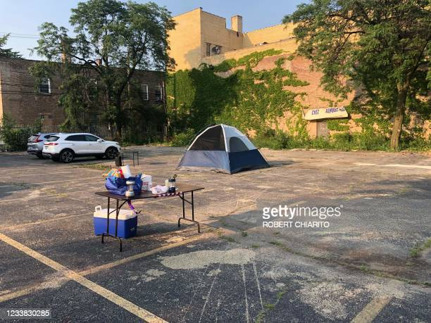 Tent is set up in a parking lot where mothers of children in one of Chicago's most violent neighborhoods go on hunger strike against violence, which...