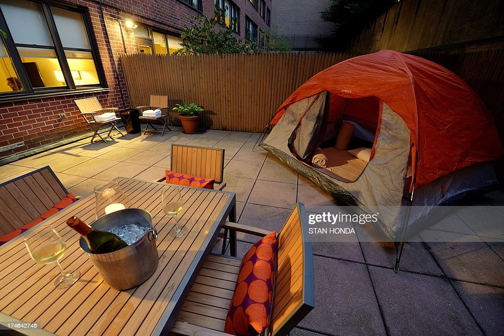 A tent on a brick patio of a ground floor room in the Affinia