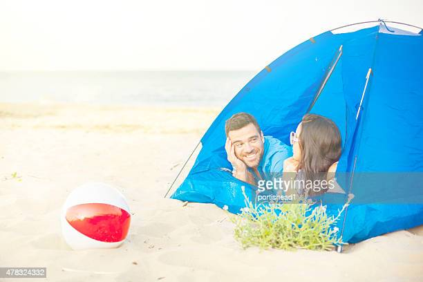 tent on the beach - windbreak stock pictures, royalty-free photos & images
