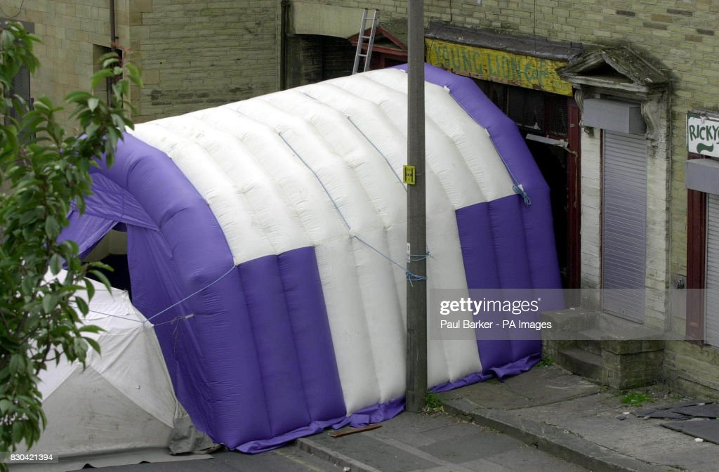 A tent outside the Young Lions Cafe on Lumb Lane Bradford covering the scene & Bradford shooting police tent Pictures | Getty Images