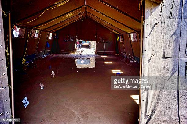 A tent that housed migrants flooded by rain at a camp setup by the Red Cross close to the Tiburtina train station in Rome Hundreds of migrants from...