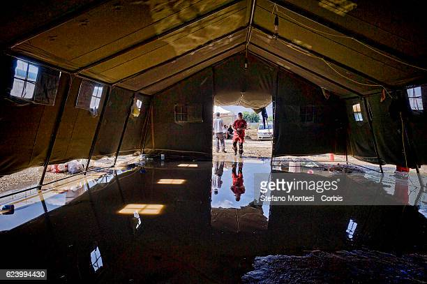 A tent that housed migrants flooded with rain at a camp setup by the Red Cross close to the Tiburtina train station in Rome Hundreds of migrants from...
