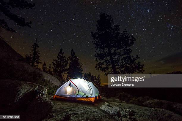 A tent under the night sky.